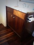 Hand crafted veneer and carved bathroom vanity, in walnut. Bespoke design.