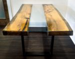 """$2500.  37"""" wide  96"""" long.  32"""" high  4"""" thick Table live-edge pine with glass insert and steel supports"""
