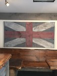 $500 United Empire Loyalist  Flag, made  of century  barn board, graces the  wall as a mural