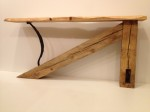 $900.  Console table. made of antique hewn timbers, with automotive leaf-spring support, and live-edge pine top