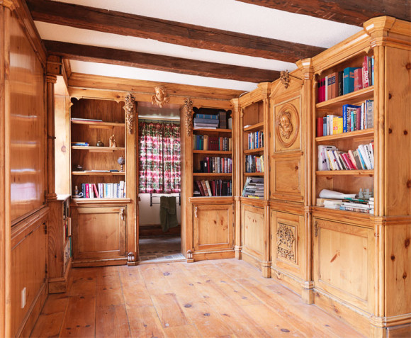 This residential library room was designed, carved  and built in a Victorian Gothic style.